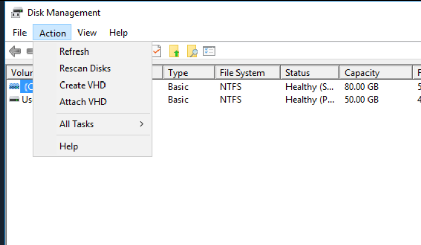 """Machine generated alternative text: Disk Management  File Action View Help  Volur  Refresh  Rescan Disks  Create VHD  Attach VHD  All Tasks  Help  File S  NTFS  NTFS  em  Status  Healthy  Healthy (P.""""  Ca ac-  80.00  50.00"""